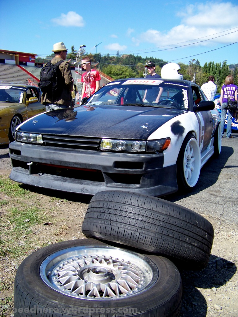 I love pics of cars with their tire piles in front. No, I don't care what you think.